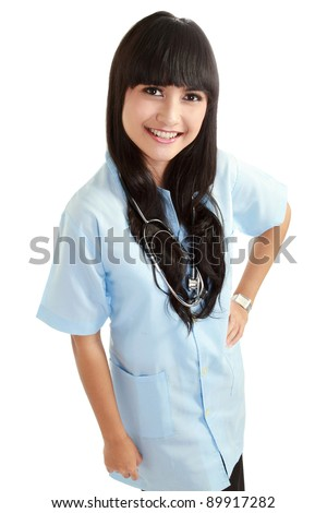 Portrait of an attractive female doctor standing against isolated white background - stock photo