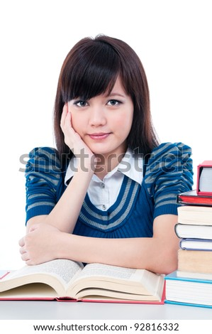 Portrait of an attractive female student with her hand on chin over white background.