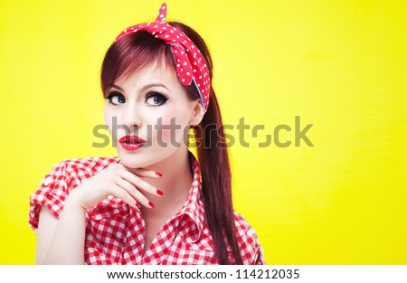Portrait of an attractive girl looking up - stock photo