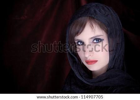 Portrait of an attractive girl with a scarf hijab - stock photo