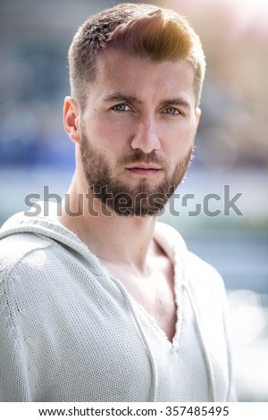 Portrait of an attractive man outdoor - stock photo