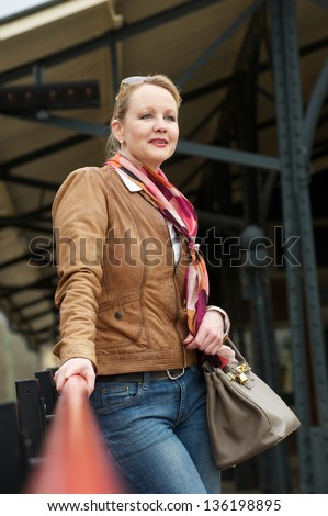 Portrait of an attractive middle aged woman standing outdoors