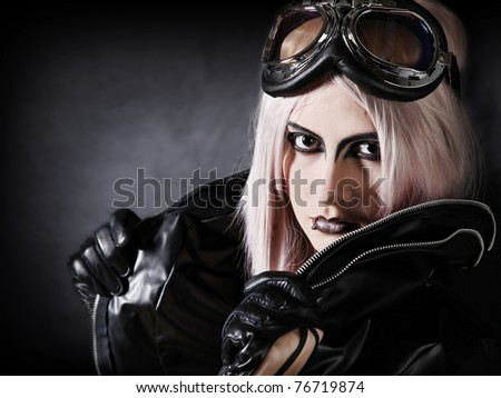 Portrait of an attractive punk girl - stock photo