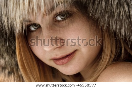 portrait of an attractive red-haired girl in a fur hat