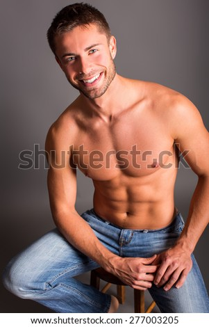 Portrait of an attractive smiling man shirtless  - stock photo