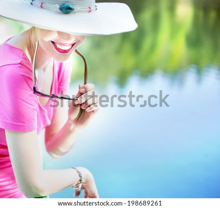 portrait of an attractive smiling woman on vacation - stock photo