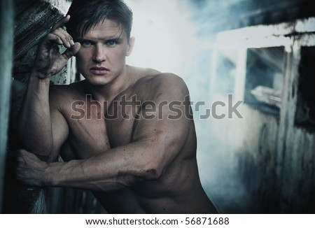 Portrait of an attractive strongman - stock photo