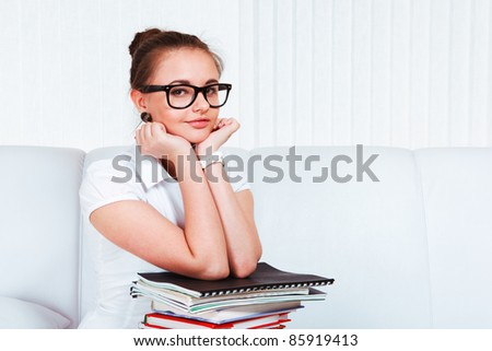 Portrait of an attractive student with books