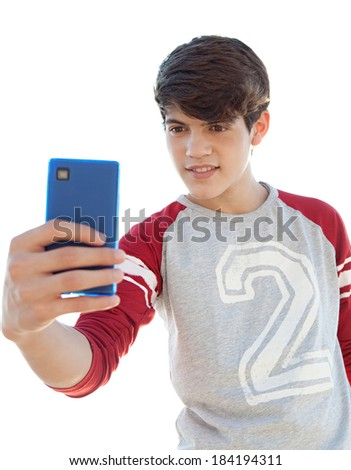 Portrait of an attractive teenager boy holding his smartphone with his hand and taking a selfie of himself against a sunny sky. Using smart phone technology outdoors to take photos. - stock photo