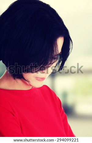 Portrait of an attractive thoughtful woman - stock photo