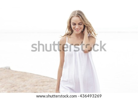 portrait of an attractive woman enjoying summer on the beach - stock photo