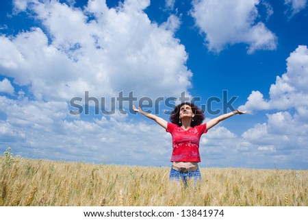 Portrait of an attractive woman in a wheat field