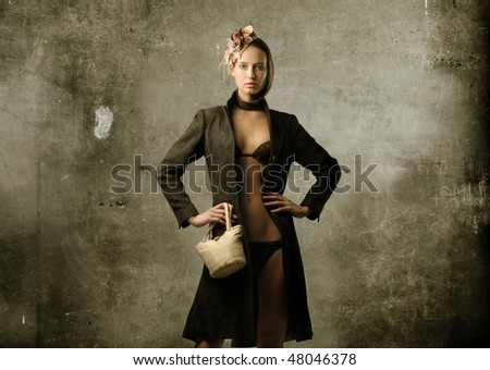 Portrait of an attractive woman in lingerie and dressing suit - stock photo