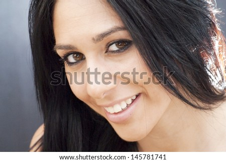 Portrait of an attractive woman on black background