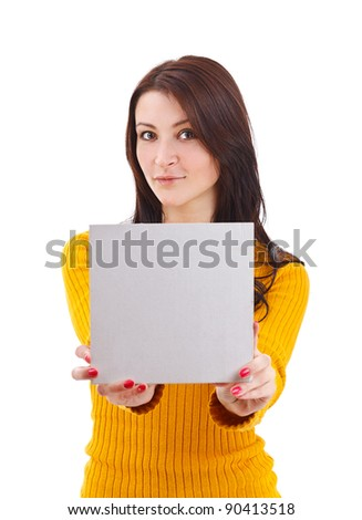 Portrait of an attractive young adult woman holding blank card - over white background