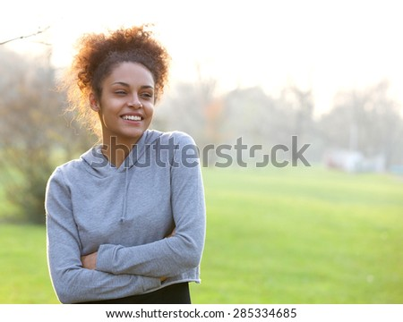 Portrait of an attractive young african american woman outdoors - stock photo