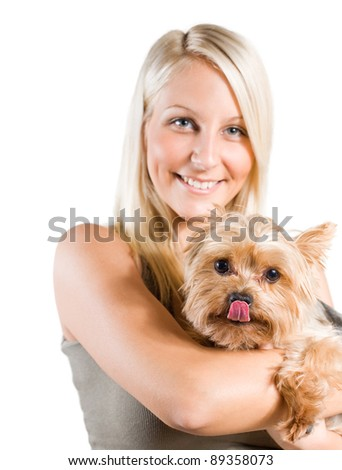 portrait of an attractive young blond woman and her dog. - stock photo