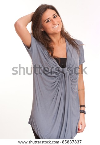 Portrait of an attractive young brunette in casual clothes - stock photo