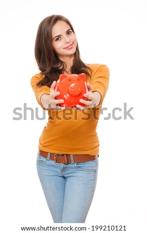 Portrait of an attractive young brunette with piggy bank. - stock photo