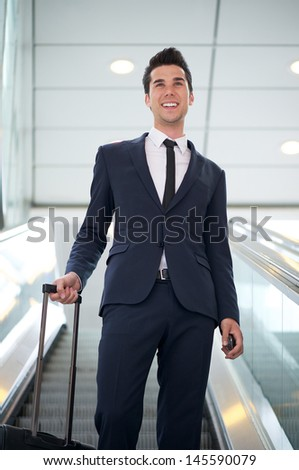 Portrait of an attractive young businessman traveling with bag - stock photo