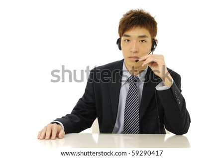 Portrait of an attractive young businessman with a headset on - stock photo