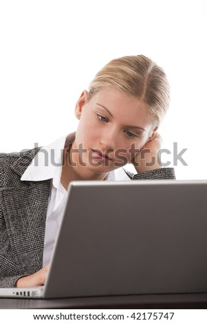Portrait of an attractive young businesswoman working on her laptop