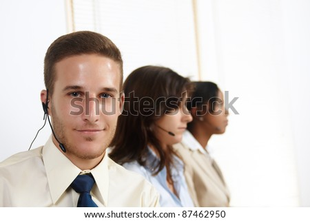 Portrait of an attractive young Caucasian man telemarketer. - stock photo