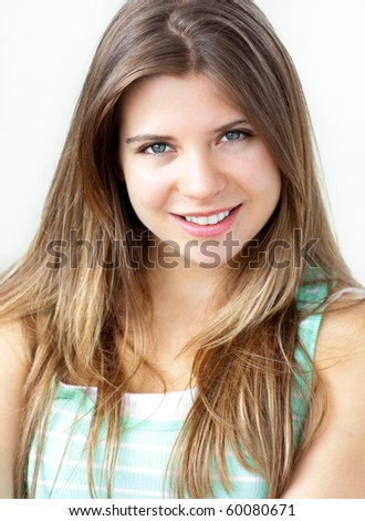Portrait of an attractive young caucasian woman looking at the camera at home