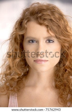 Portrait of an attractive young female, blond, long hair, blue eyes. - stock photo