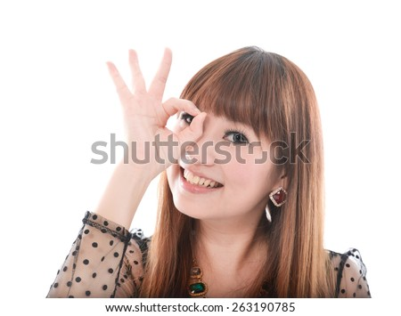 portrait of an attractive young female showing ok gesture - stock photo