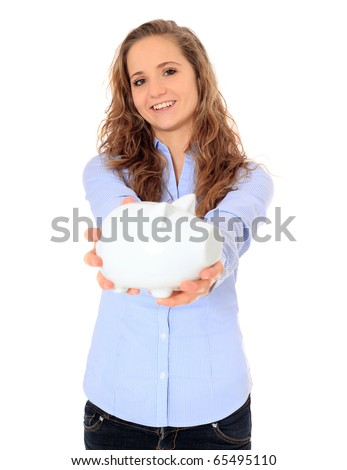Portrait of an attractive young girl holding her piggy bank. All on white background. - stock photo