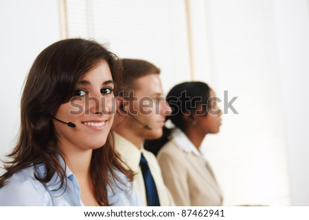 Portrait of an attractive young Hispanic woman telephone operator. - stock photo