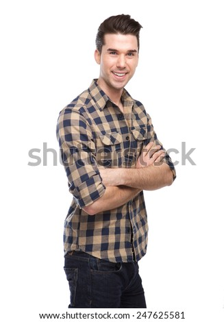 Portrait of an attractive young man smiling with arms crossed on isolated white background - stock photo