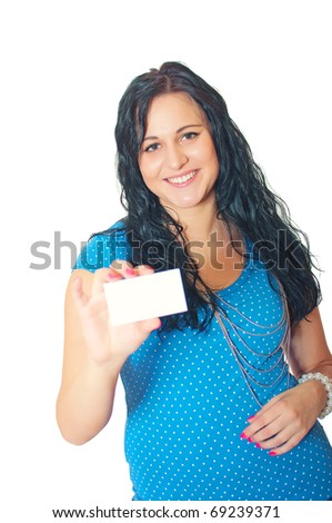 Portrait of an attractive young smiling woman showing blank business card isolated over white background
