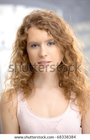 Portrait of an attractive young woman, blond, long hair, blue eyes. - stock photo