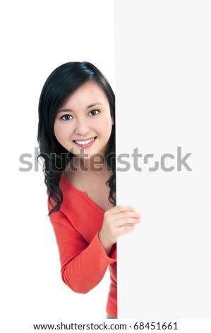 Portrait of an attractive young woman holding a billboard, over white background.