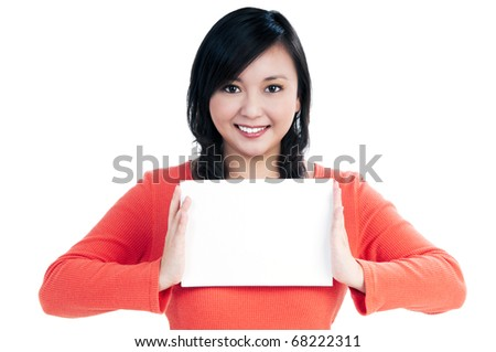 Portrait of an attractive young woman holding a blank note card, over white background.