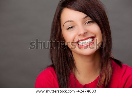 portrait of an attractive young woman in a red top. - stock photo