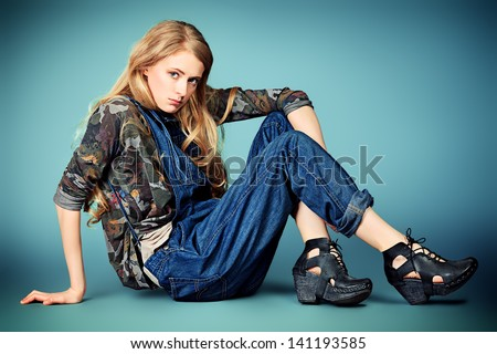 Portrait of an attractive young woman in jeans clothing. - stock photo