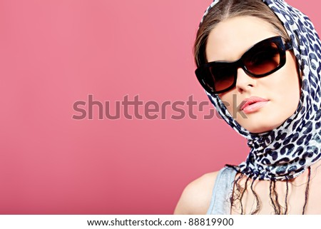 Portrait of an attractive young woman in sunglasses. Retro style. - stock photo