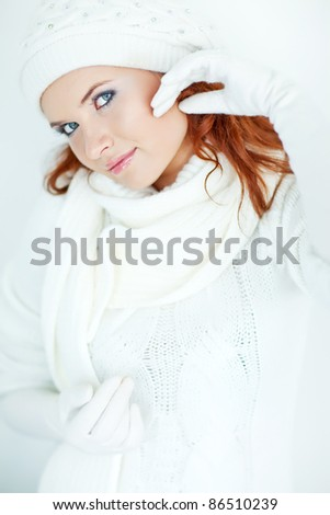 Portrait of an attractive young woman in winter clothing - stock photo