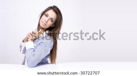 Portrait of an attractive young woman, isolated on a white background.. - stock photo
