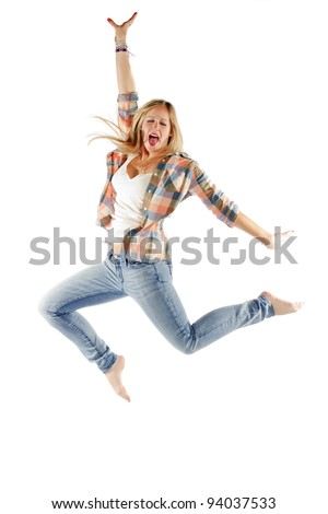 Portrait of an attractive young woman jumping with joy on white background - Vertical composition