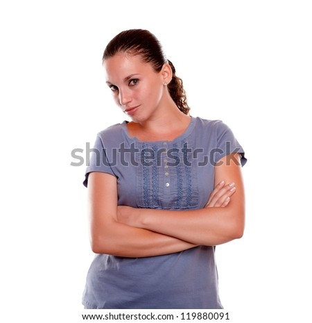 Portrait of an attractive young woman looking at you on blue shirt against white background - stock photo
