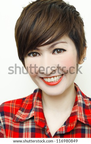Portrait of an attractive young woman short hair smiling. Isolated on white background. - stock photo