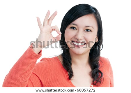 Portrait of an attractive young woman showing OK sign over white background.