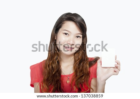 Portrait of an attractive young woman standing - stock photo