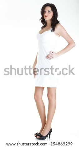 Woman standing in white dress