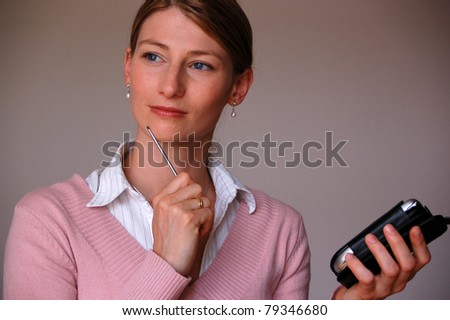 Portrait of an attractive young woman thinking about something - stock photo