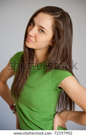 Portrait of an attractive young woman with a defiant expression - stock photo